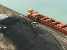 Petroleum coke being loaded onto a barge on the Detroit River.