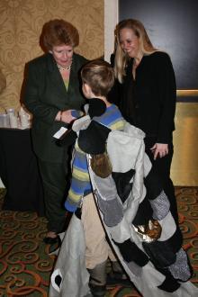 US Senator Stabenow, Michigan LCV executive director Lisa Wozniak & child